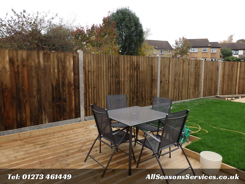 Cloase board fence with concrete gravel boards